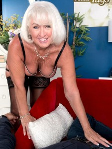 Granny Jeannie Lou jerks off a young stud